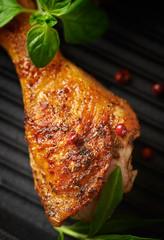 Spicy Chicken Leg with Herbs. Roasted chicken drumstick, crispy golden brown skin. Top view.