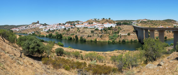 The panoramic view of Mertola town and the bridge over the Guadiana river. Portugal