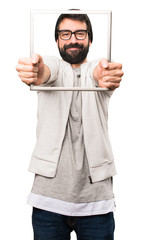 Happy Hipster man with framework on white background