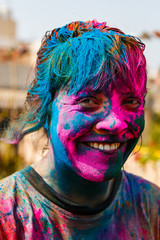 European woman with colors on her face