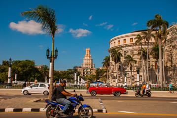 Capitolio Nacional, El Capitolio. Old classic retro cars and motorbikes are on the way. Havana. Cuba
