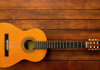 Guitar on the Wooden Background