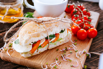 Sandwich with tomato, cheese and  lettuce