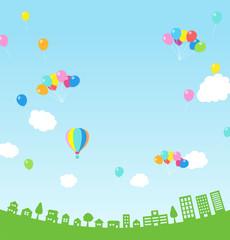 高い青空に風船&気球と街並み|背景素材