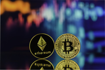Bitcoin and Ethereum with reflexion against blurry background.