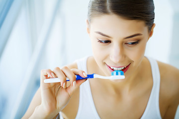 Woman With Beautiful Smile, Healthy White Teeth With Toothbrush. High Resolution Image