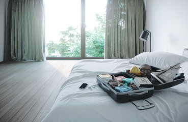 open travel case in hotel bedroom travel vacation concept background