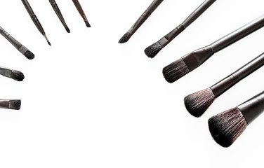 brushes for makeup on a white background, view from above