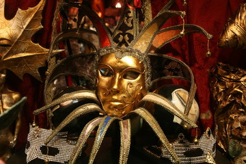 olly venetian carnival mask with gold colored decorations