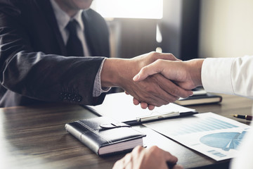 Meeting and greeting concept, Two confident Business handshake and business people after discussing good deal of Trading contract and new projects for both companies, success, partnership, co worker Wall mural