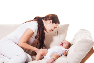 Young mother soothes baby