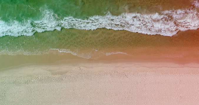 Drone panorama of Barra da Tijuca beach with colored light leak, Rio de Janeiro, Brazil.