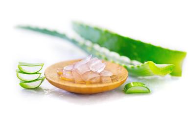 Aloe Vera gel closeup. Sliced Aloevera natural organic renewal cosmetics, alternative medicine. Organic skincare concept. Isolated on white background