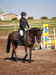 Smilling young girl happy after win the showjumping competition