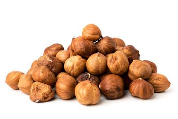 Pile of hazelnuts on white background isolated.
