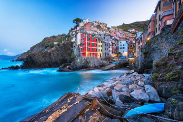 View on the colorful houses along the coastline of Cinque Terre area in Riomaggiore