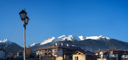 View of snowy pirin mountais from Bansko sity in Bulgaria