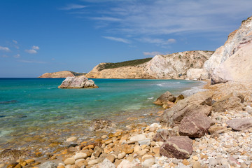 Rocks and blue sea water in summer day. Greece