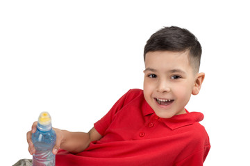 Half length emotional portrait of little boy wearing redt-shirt with small bottle of water .