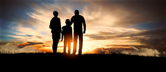 Family together, parents with their child at sunset, worried about their future.