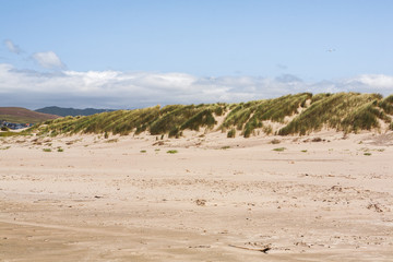 View from a beach of Sand Dunes in a distant, in Morrow Bay California