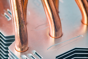 Aluminum radiator with copper heat pipe close-up with beautiful bokeh