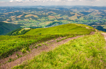 foot path down the grassy hillside. location mountain Gymba, TransCarpathia, Ukraine. tourists climbing hill in the distance. great summer outdoor activities