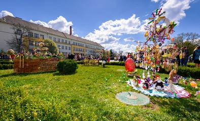 Uzhgorod, Ukraine - April 07, 2017: Celebrating Orthodox Easter in Uzhgorod on the Narodna square. Celebration in front of Transcarpathian Regional Administration building on a warm springtime day