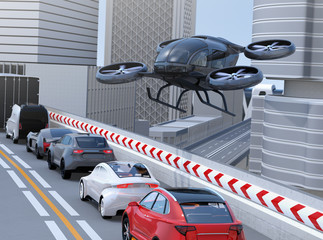Black passenger drone flying over cars in heavy traffic jam. Concept for drone taxi. 3D rendering image.