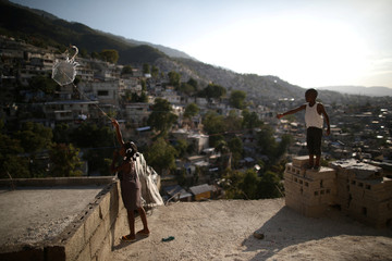 Children play with a kite in Port-au-Prince