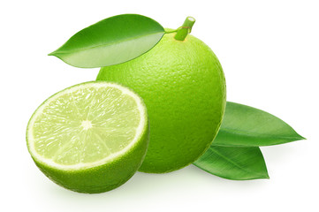 Whole fresh lime fruit with half and green leaves