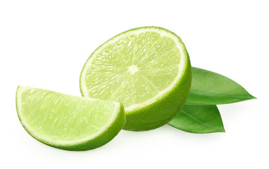 Half and slice of fresh lime fruit with green leaves