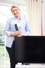 Portrait Of Proud Woman With New Television At Home