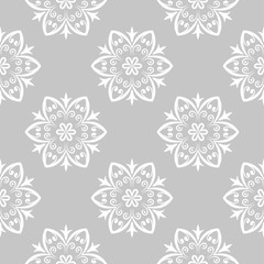 Gray and white floral ornament. Seamless pattern
