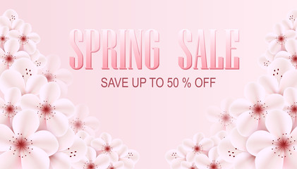Spring sale banner with pink sprin flowers