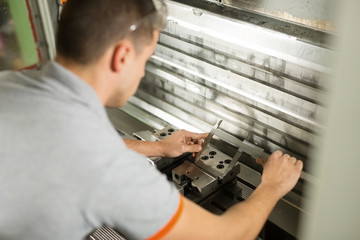 Metal Worker Using CNC Machine