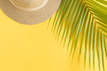 Flat lay photo coconut leaf and hat on yellow background , top view and copy space for montage your product