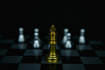Leadership Concepts. Chess is a leader.  Comparing chess is a strategic business plan. Businessman is playing chess. Chess game on a black background.