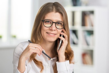 portrait of a mature business woman in glasses in the office