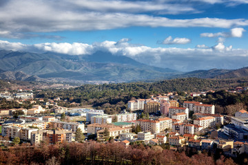 Corte, a beautiful city in the mountains on the island of Corsica, a view of the city and the mountains