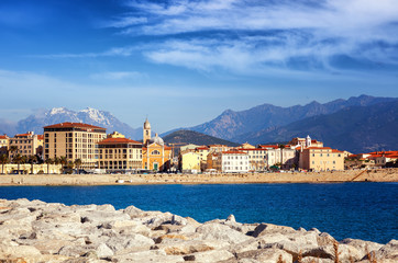 Wall Mural - Beautiful cityscape, Ajaccio is the capital of Corsica. City on a background of snowy mountains and blue sky