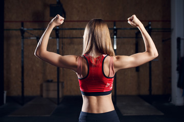 Photo from back of female athlete showing biceps