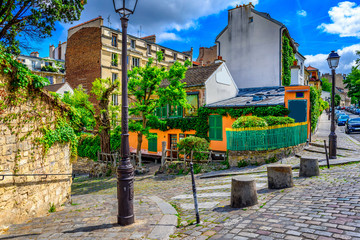 Cozy street of old Montmartre in Paris, France