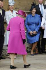 Britain's Queen Elizabeth and other members of Britain's royal family arrive for the annual Easter Sunday service at St George's Chapel at Windsor Castle in Windsor