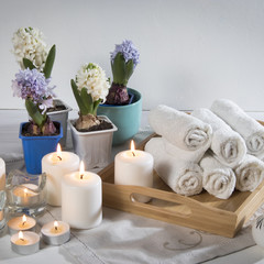 the Tray with hand towels, hyacinths in pots in the bathroom of the spa salon