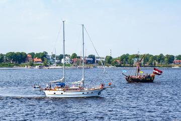 Ship floats the river Daugava