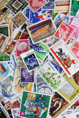Old post stamps from various countries and times. Mix collection as background