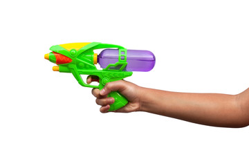 Hand holding plastic water gun isolated on white background. Objects with clipping path