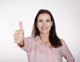 Geschäftsfrau zeigt daumen hoch