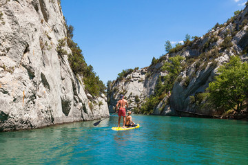 People doing standing paddle in  Gorge du Verdon canyon river in south of France Wall mural